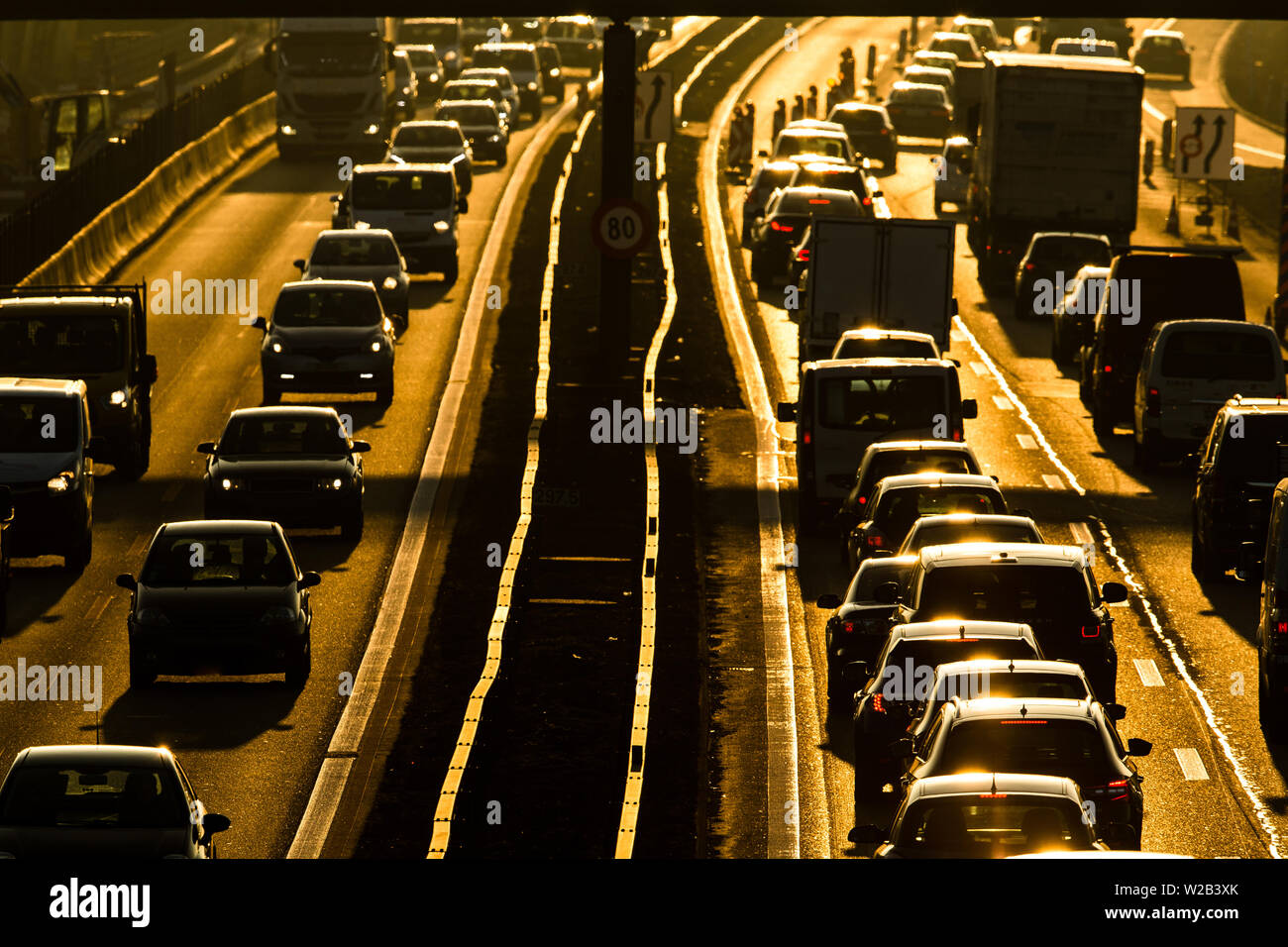 Heavy morning city traffic/congestion concept - cars going very slowly in a traffic jam during the morning rushhour - Stock Image
