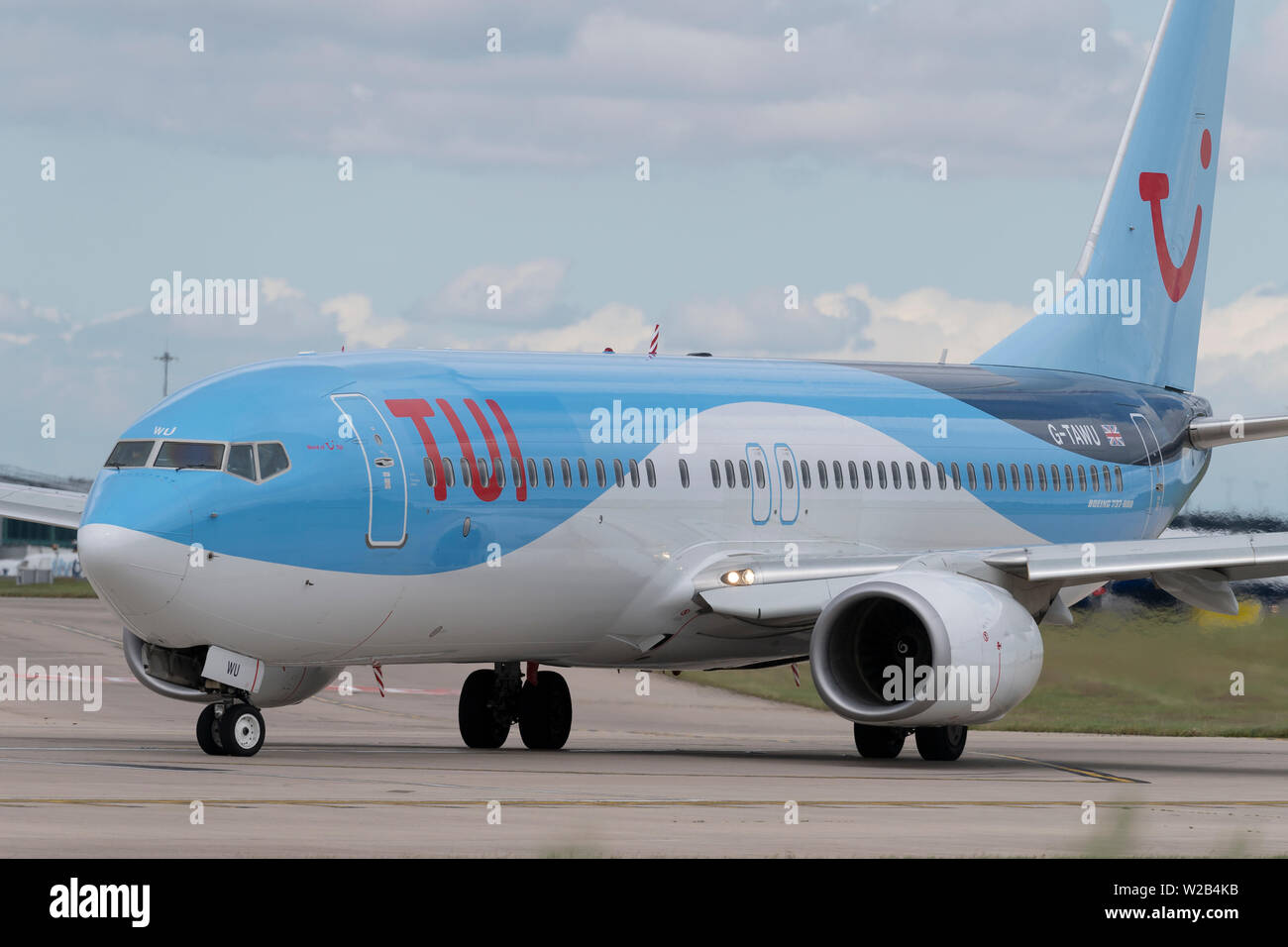 A TUI Boeing 737-800 taxis on the runway at Manchester Airport, UK. - Stock Image