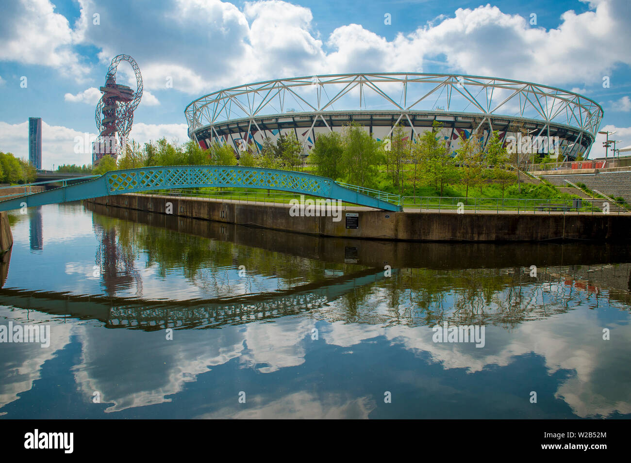 LONDON - APRIL 20, 2019: London Stadium reflects in one of the Bow Back Rivers, which were cleaned up when Stratford was revitalised for the  Olympics. Stock Photo