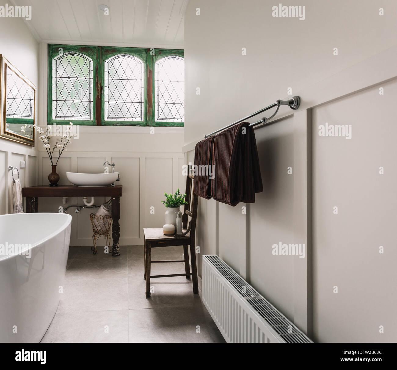 Country Bathroom With Bath Gold Mirror Green Historic Double Casement Headlight Window Stock Photo Alamy