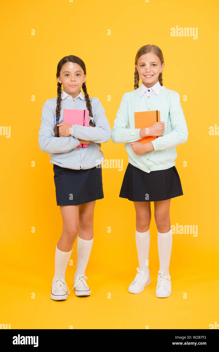 Knowledge day. School day fun cheerful moments. Kids cute students. Schoolgirls best friends excellent pupils. Secondary school. Schoolgirls tidy appearance school uniform. School friendship. - Stock Image