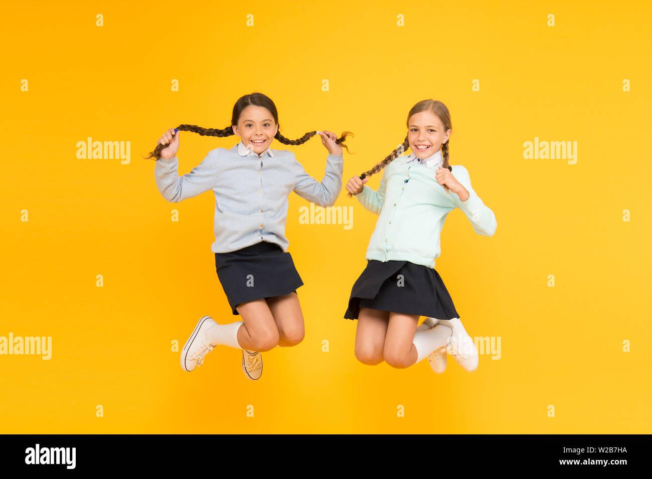 Secondary school. Kids cute students. Schoolgirls best friends excellent pupils. Schoolgirls tidy appearance school uniform. School friendship. Knowledge day. School day fun cheerful moments. Stock Photo