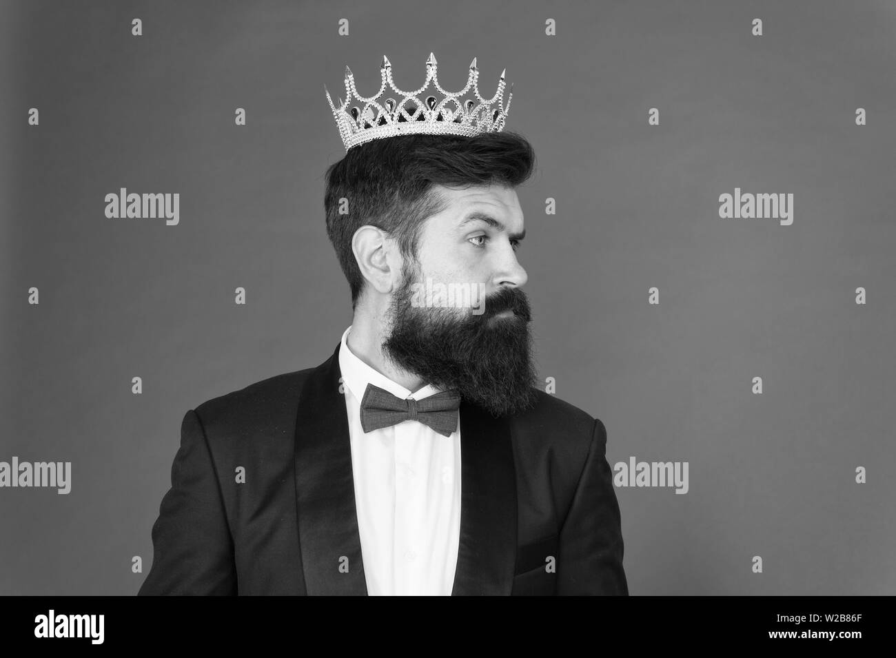 vip. Big boss. Formal event. King crown. Formal wear male fashion. Egoist. Businessman in tailored tuxedo and crown. Vip man in suit. Bearded man in tuxedo and bow tie at vip party. vip client. - Stock Image