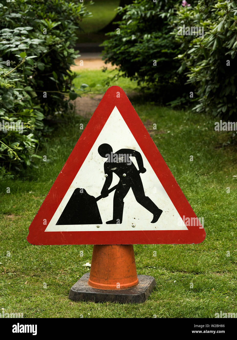 A sign warns of the hazardous area around tree cutting. - Stock Image