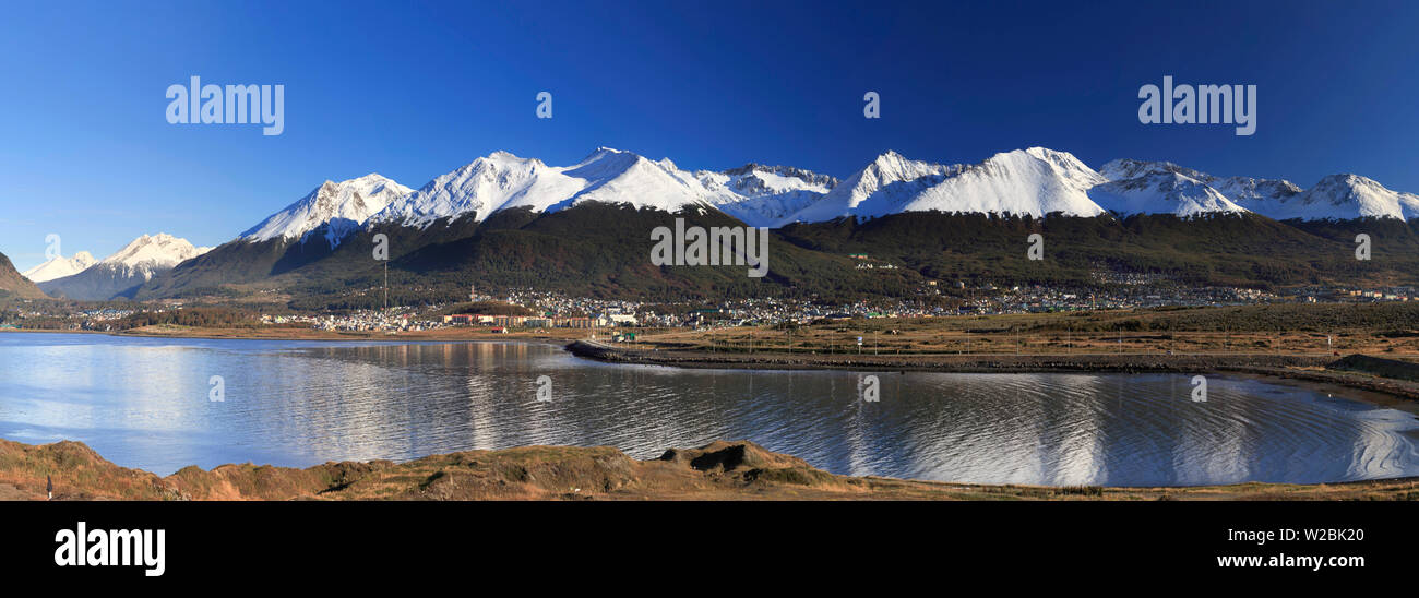 Argentina, Tierra del Fuego, Ushuaia, Beagle Channel and view of Ushuaia town with Andes in the Background - Stock Image