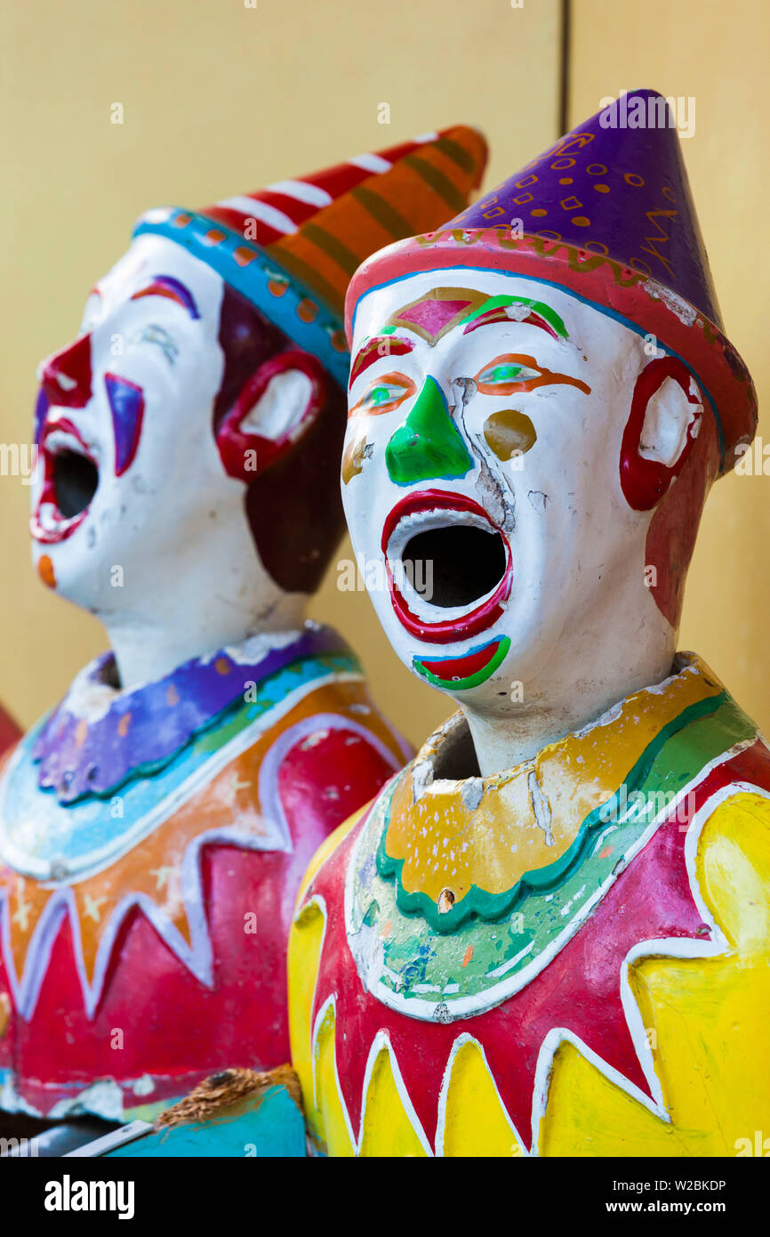 Australia, South Australia, Adelaide, Rundle Park, The Garden of Unearthly Delights, clown heads at water gun concession - Stock Image