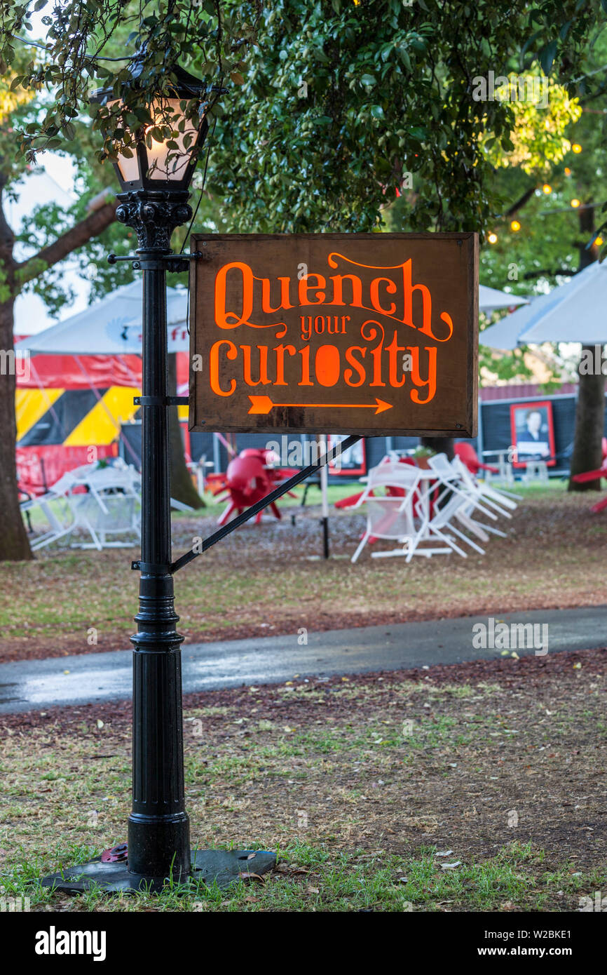Australia, South Australia, Adelaide, Rundle Park, The Garden of Unearthly Delights, Quench Your Curiosity, sign - Stock Image