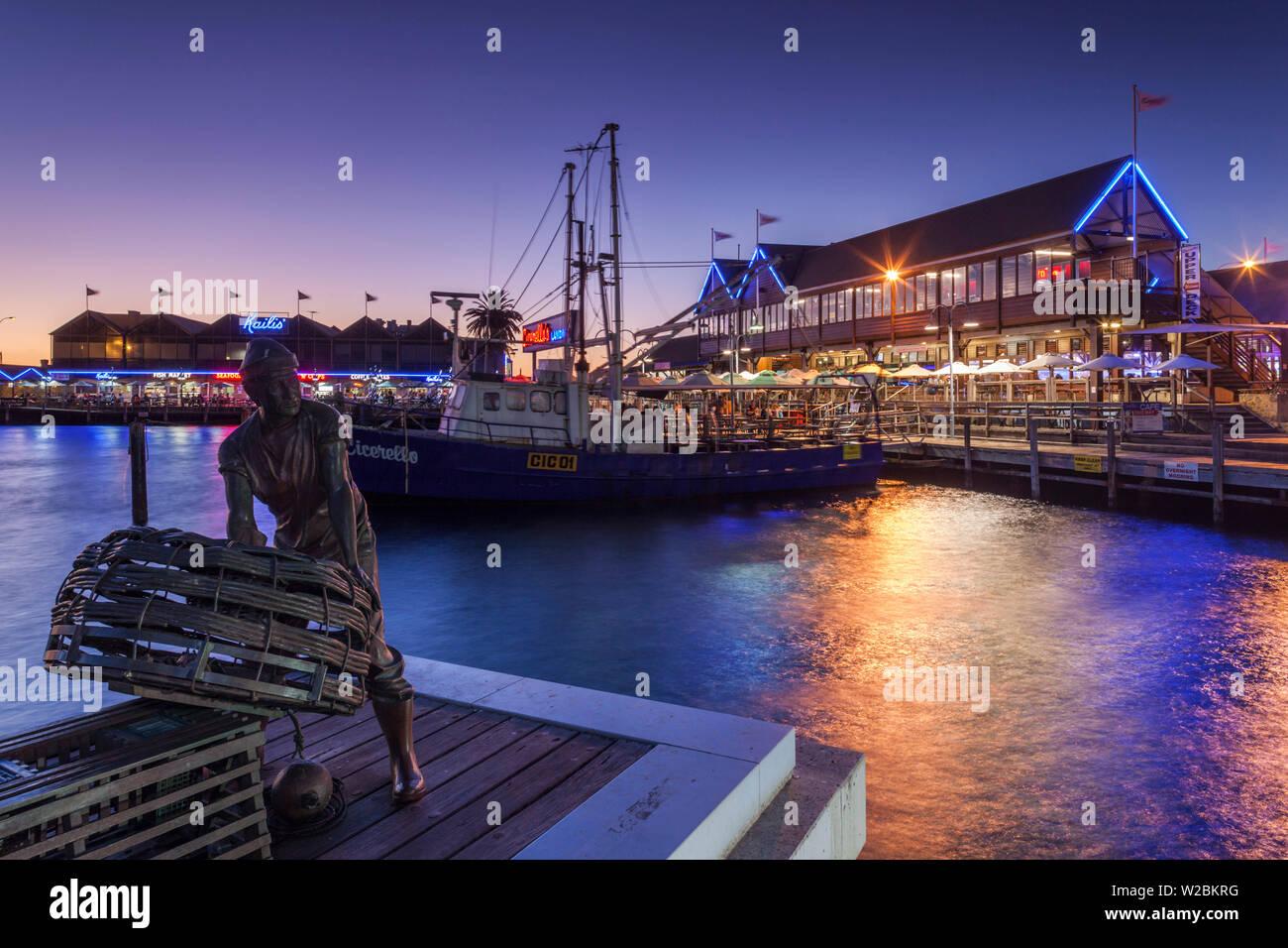 Australia, Western Australia, Freemantle, Fishing Boat Harbour, eveing with Fishermen's Memorial sculpture by Greg James and Jon Tarry - Stock Image