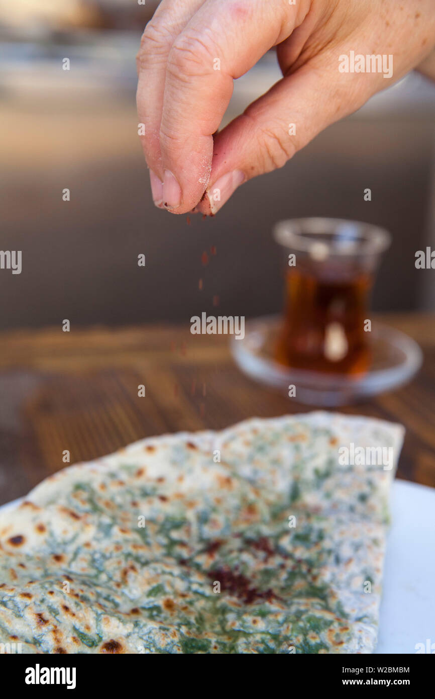 Azerbaijan, Baku, he Old Town - Icheri Sheher, Azerbaijani traditional bread with herbs and tea - Stock Image