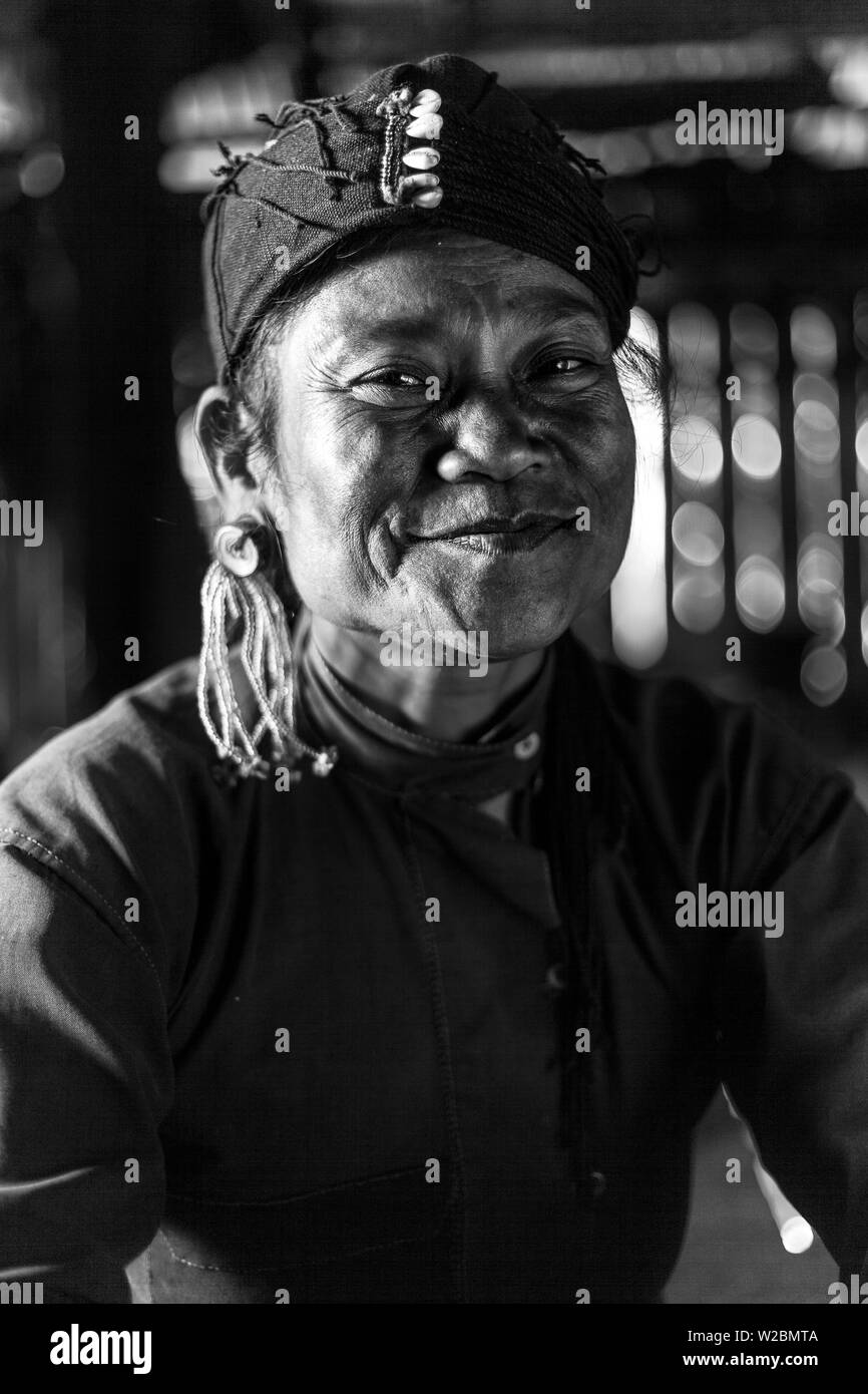A woman of the small Ann tribe, with blackened teeth to ward off evil spirits & who believe that to be black on the outside is to be white & pure within, nr Kyaing Tong, Golden Triangle, Myanmar (Burma) - Stock Image