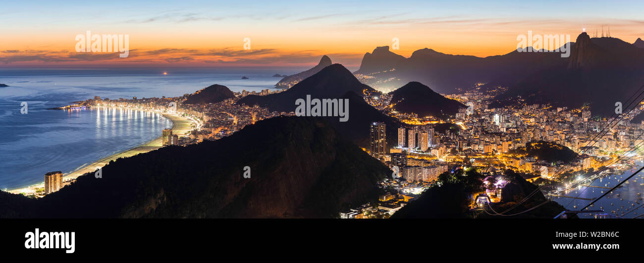 Mount Corcovado and the city at sunset from Sugarloaf (Pao de Acucar) in Rio de Janeiro, Brazil Stock Photo