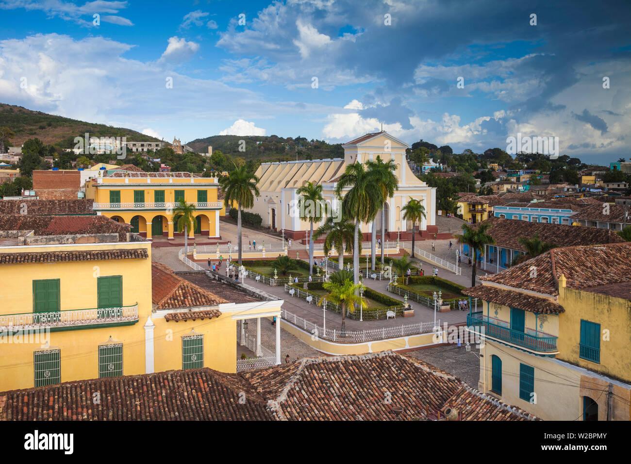 Cuba, Trinidad, View of Plaza Mayor looking towards Museum Romantico  and Iglesia Parroquial de la Santisima Trinidad - Church of the Holy Trinity, in the far distance is Ermita de Nuestra de la Candelaria de la Popa an 18th Century church now in ruins - Stock Image