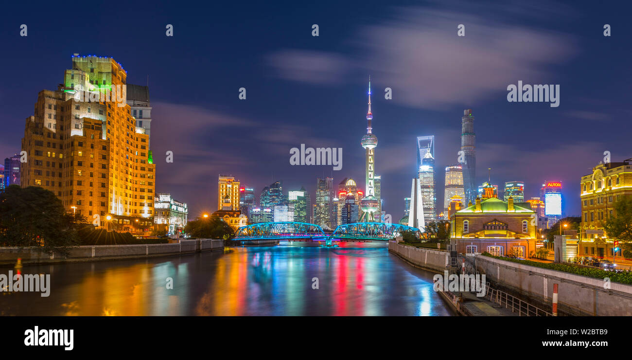China, Shanghai, Pudong District, Financial District skyline, including Oriental Pearl Tower, Waibaidu Bridge over Wusong River or Suzhou Creek Stock Photo