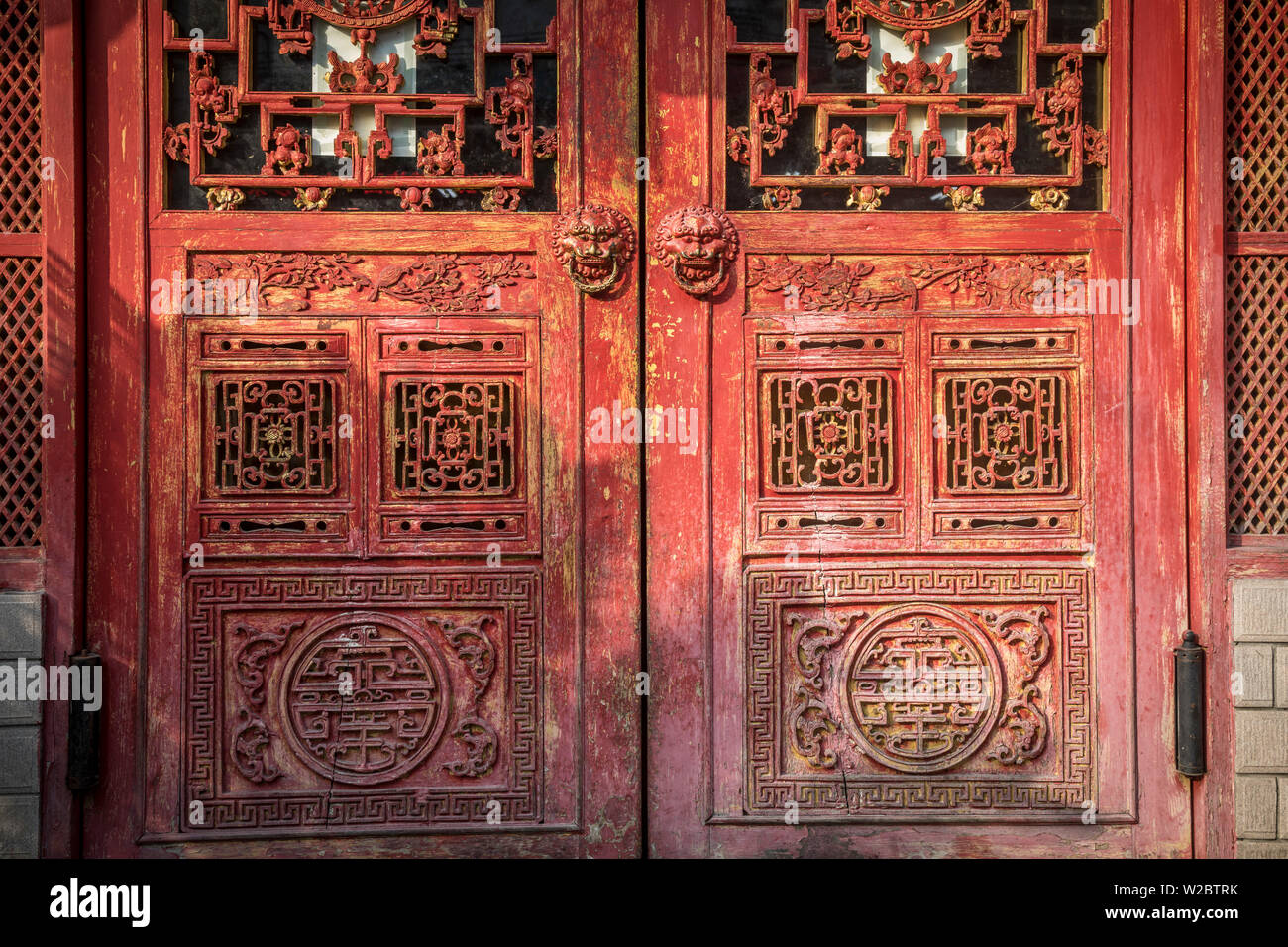 Traditional red doors in the Old City, Shanghai, China - Stock Image