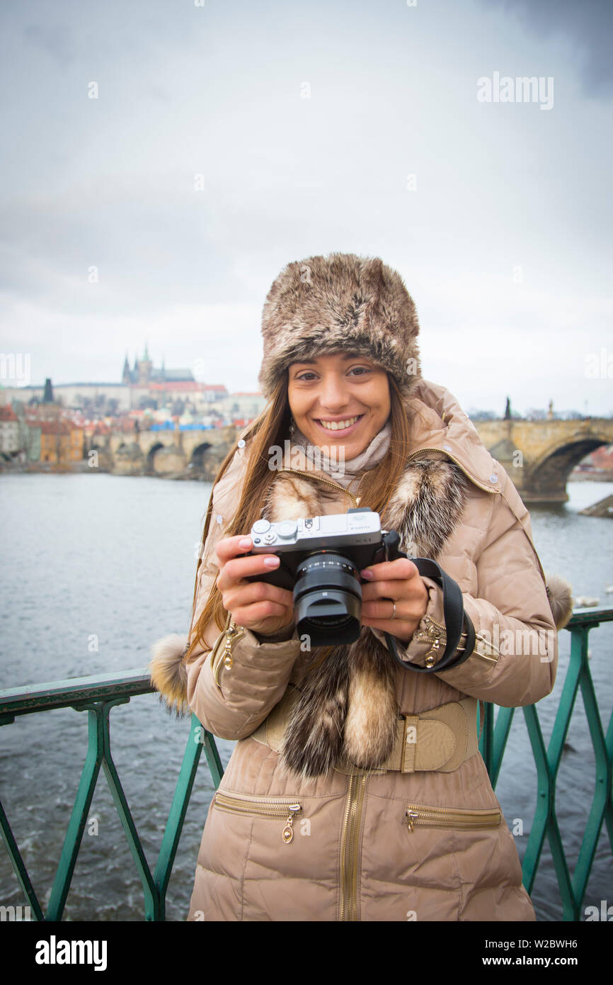 Young woman with camera, Prague, Czech Republic (MR) - Stock Image