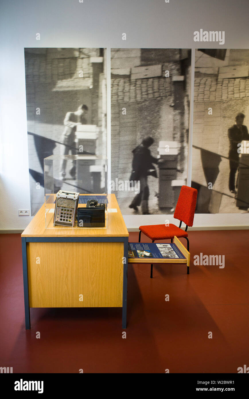 Germany, Berlin, Friendrichshain, Stasi Museum, DDR-era secret police museum in former secret police headquarters, desk with wire tapped telephone - Stock Image
