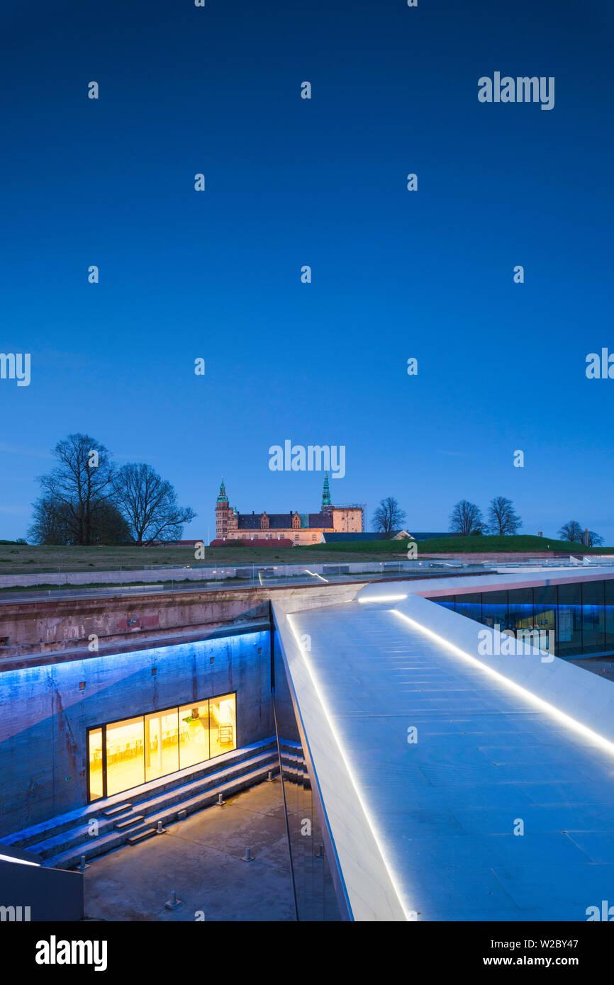 Denmark, Zealand, Helsingor, Danish Maritime Museum in underground drydock and Kronborg Castle, evening - Stock Image