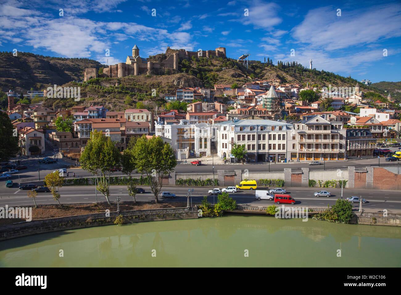 Georgia, Tbilisi, View over Mtkvari  (Kura) river towards Old Town and Narikala Fortress Stock Photo