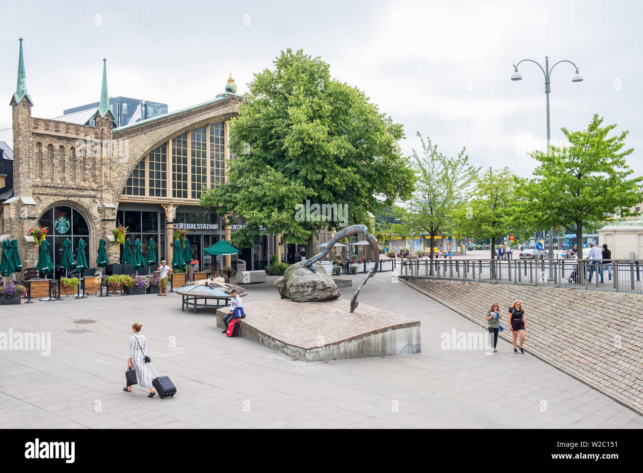 People walking outside the railway station in Gothenburg in Sweden - Stock Image