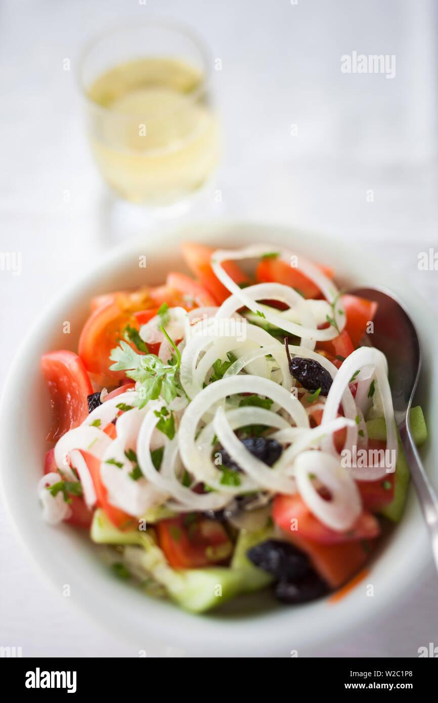 Greece, East Macedonia and Thrace Region, Kavala, Greek Salad and glass of wine - Stock Image