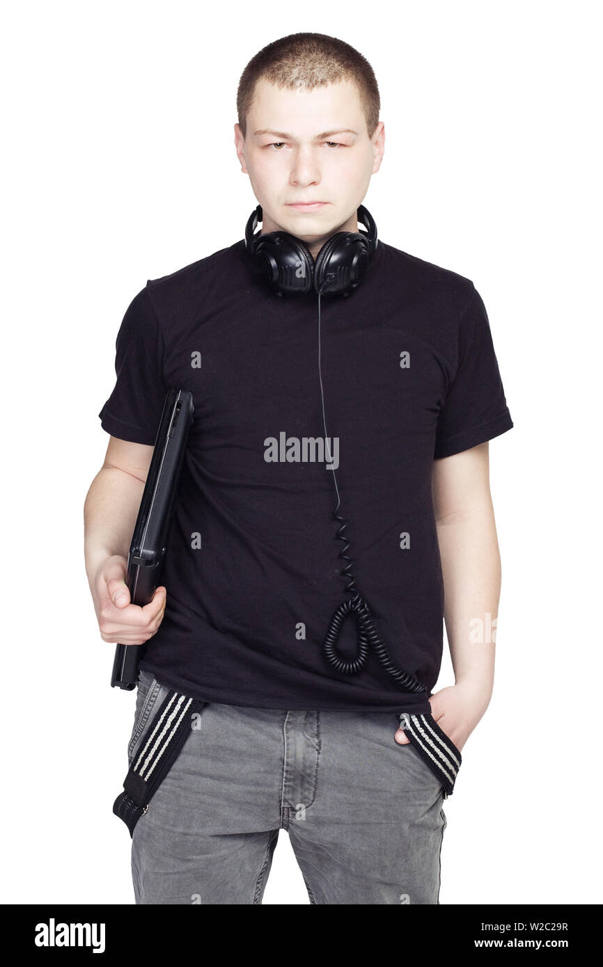 Young Man with notebook and headphones on white background Stock Photo