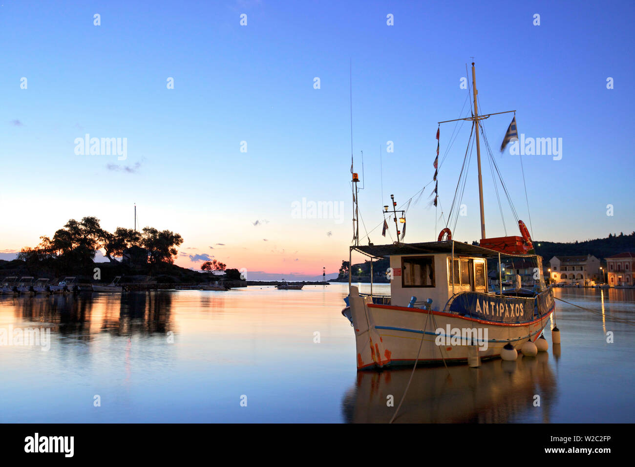 Ferry Boat in Gaios Harbour, Paxos, The Ionian Islands, Greek Islands, Greece, Europe - Stock Image