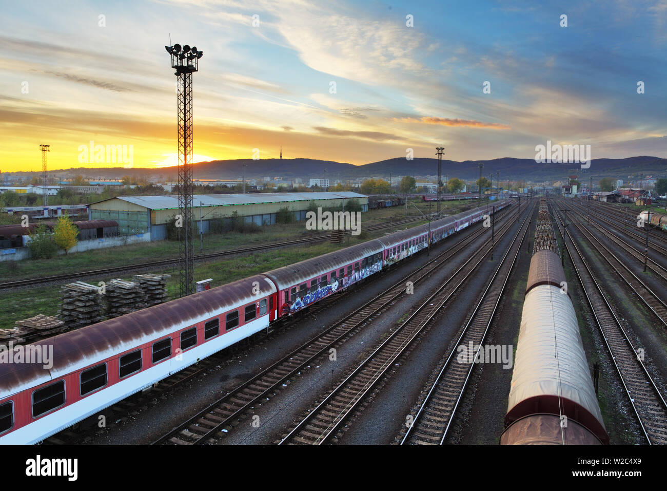 Train freight station - Cargo transportation at sunset Stock Photo