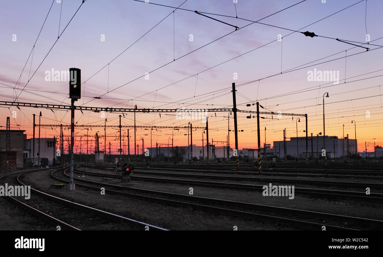 Railway Tracks at a pink  colorful sunset Stock Photo