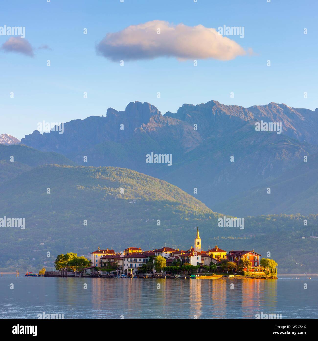The idyllic Isola dei Pescatori (Fishermen's Islands) illuminated at sunrise, Borromean Islands, Lake Maggiore, Piedmont, Italy - Stock Image