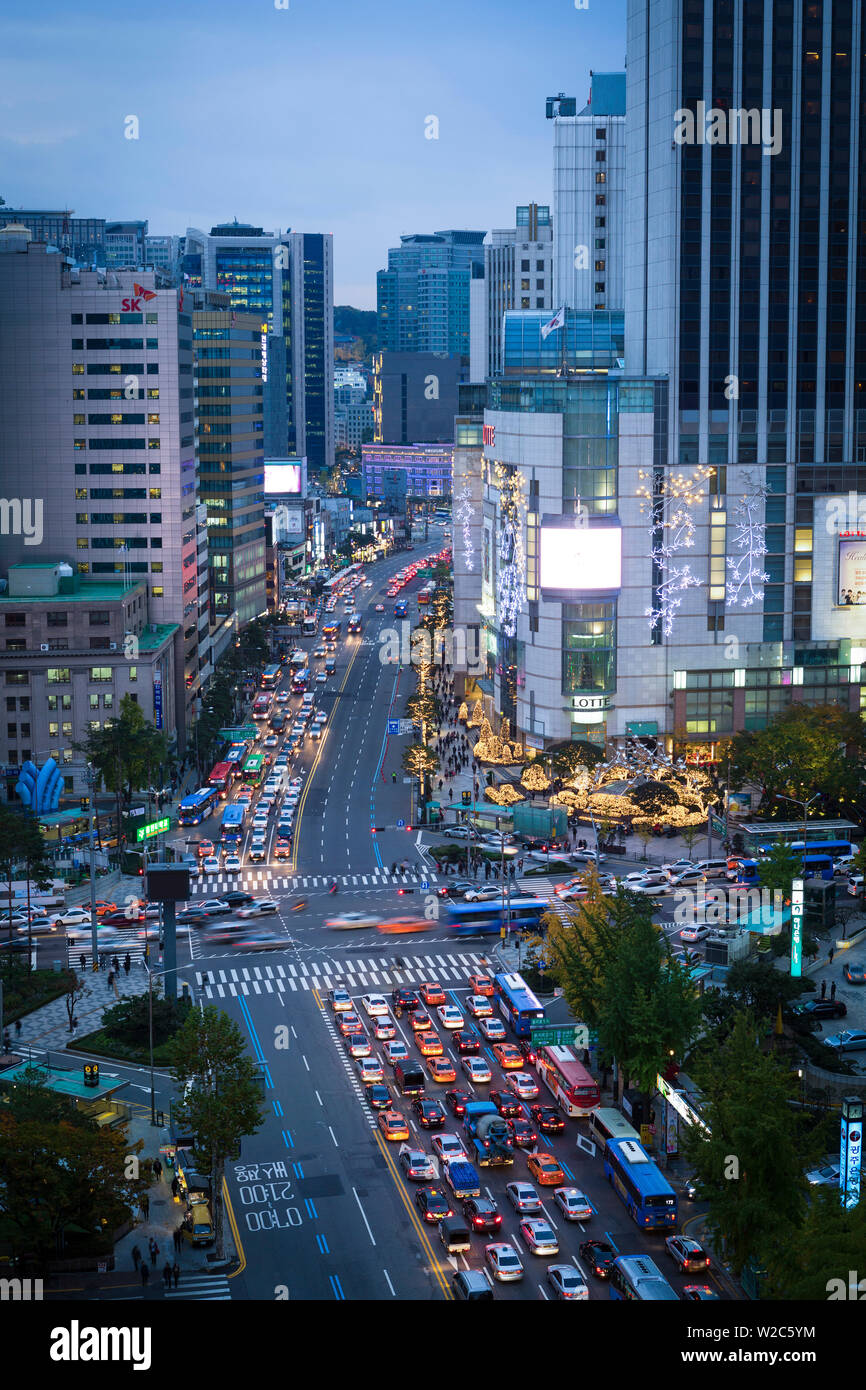 Busy Namdaemun-ro at dusk in Myeong-dong, Myeongdong, Seoul, South Korea - Stock Image