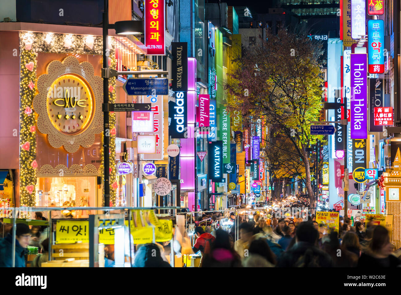 Myeong-Dong district at night. The location is the premiere district for shopping in the city - Stock Image