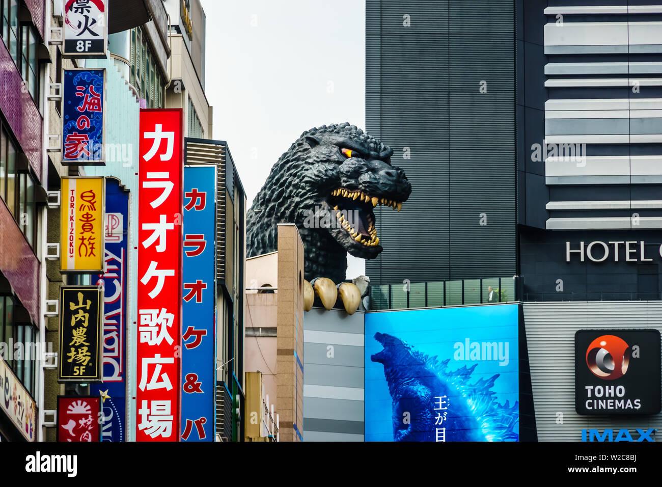 Tokyo, Japan - May 10, 2019: At Godzilla's hometown of Tokyo, a giant Godzilla Head of the scaly menace is towering over the Toho Building in Shinjuku. - Stock Image