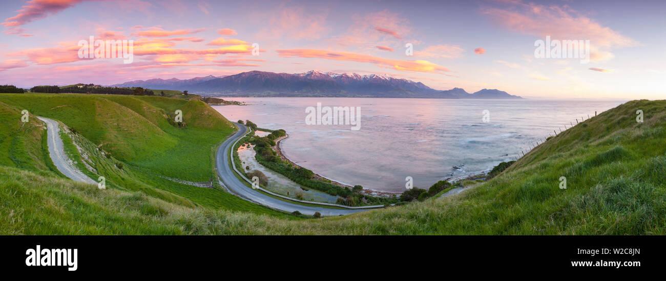 Elevated view over dramatic landscape illuminated at sunrise, Kaikoura, South Island, New Zealand - Stock Image