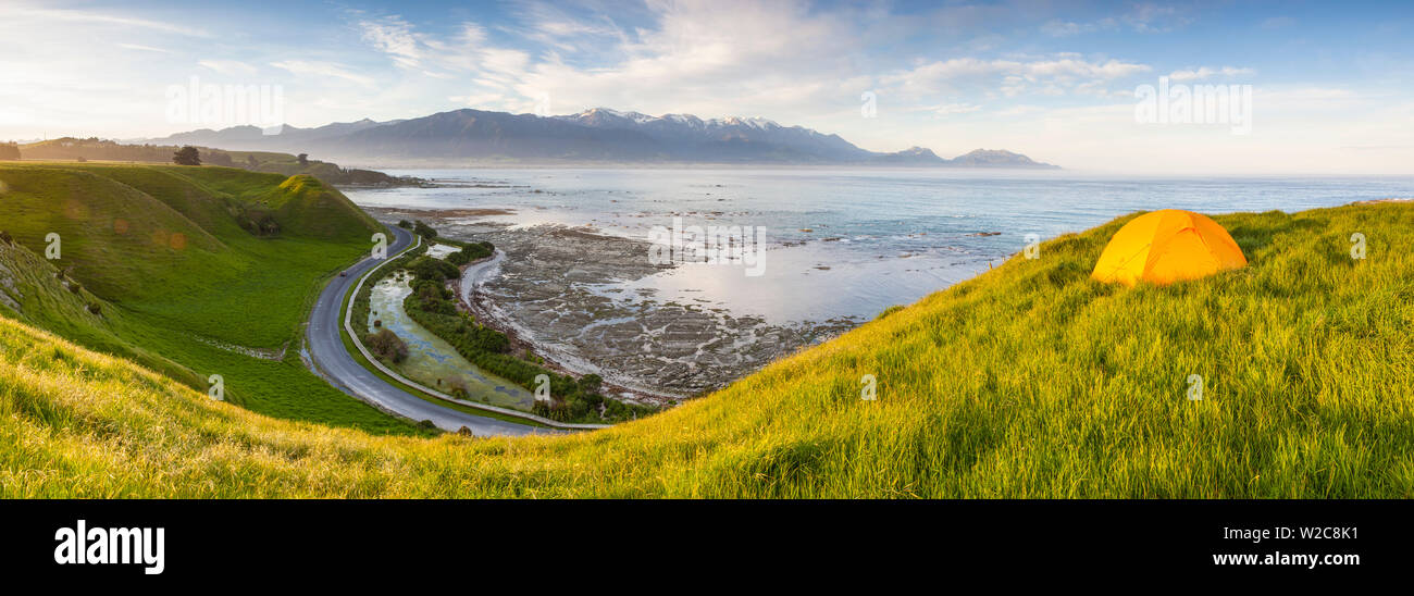 Elevated view over picturesque Kaikoura peninsula illuminated at sunset, Kaikoura, South Island, New Zealand - Stock Image