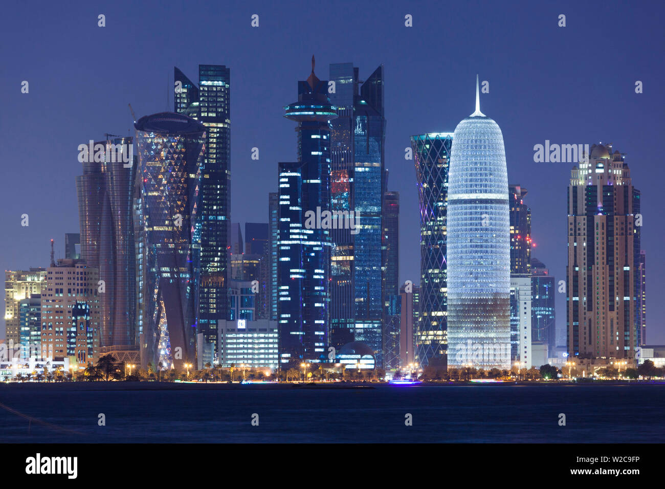 Qatar, Doha, Doha Bay, West Bay skyscrapers, dusk, with Burj Qatar Tower Stock Photo