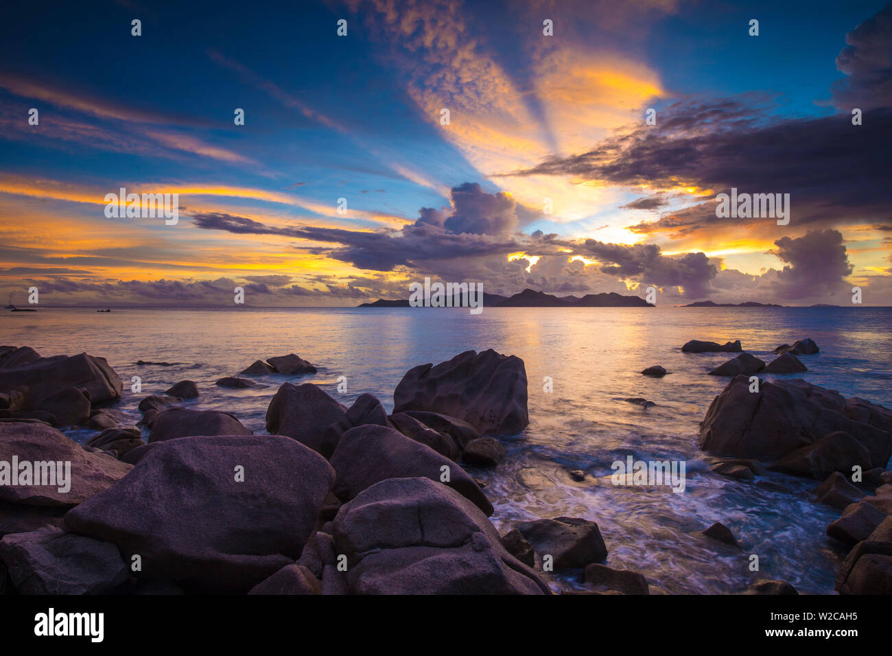 Beach at sunset, La Digue, Seychelles - Stock Image