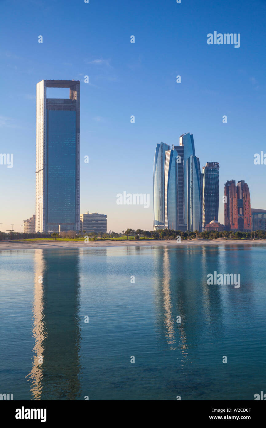 United Arab Emirates, Abu Dhabi, View of Marina and City skyline looking towards Abu Dhabi National Oil Company headquarters, Etihad Towers, and The Royal Rose Hotel - Stock Image