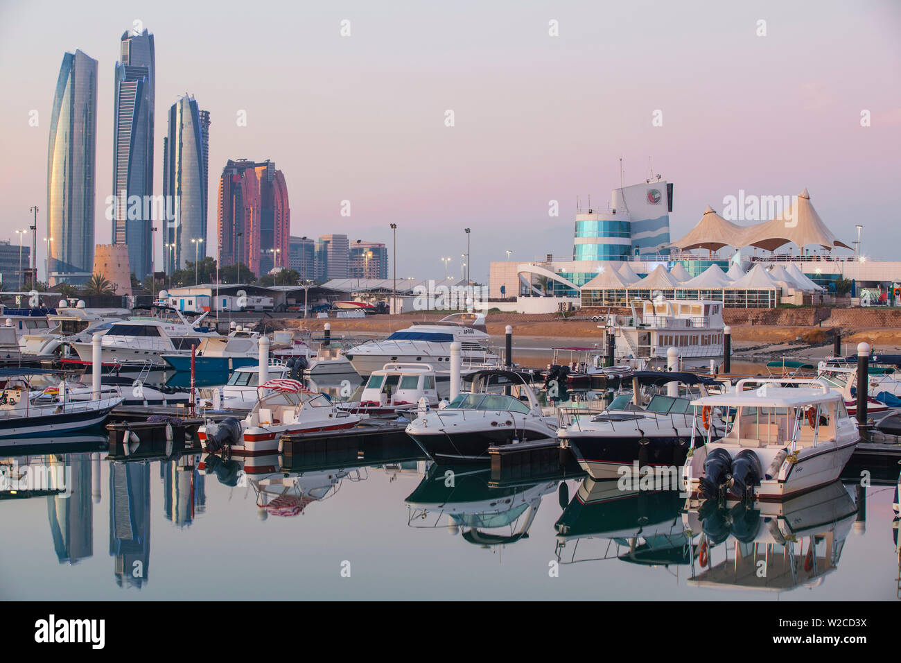 United Arab Emirates, Abu Dhabi, View of Marina and City skyline looking towards Etihad Towers and to the right the Abu Dhabi International Marine Sports Club - Stock Image