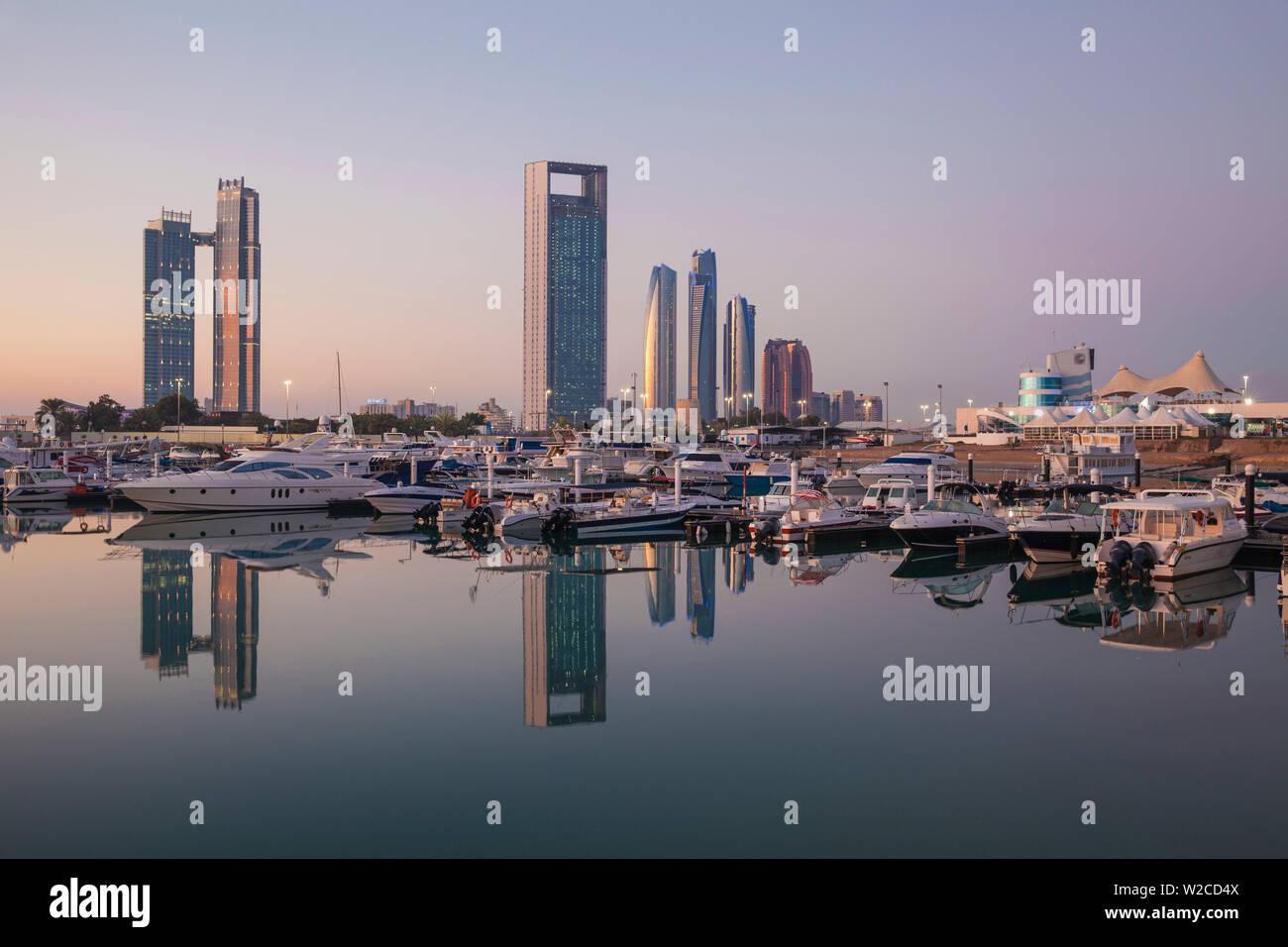 United Arab Emirates, Abu Dhabi, View of Marina and City skyline looking towards St Regis Hotel, Abu Dhabi National Oil Company headquarters, Etihad Towers, The Royal Rose Hotel and to the right the Abu Dhabi International Marine Sports Club - Stock Image