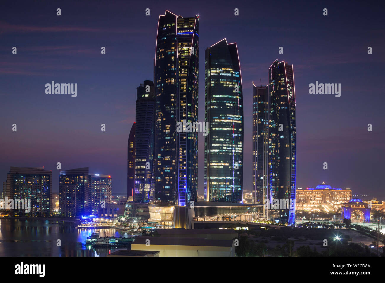 UAE, Abu Dhabi, Etihad Towers, dusk - Stock Image
