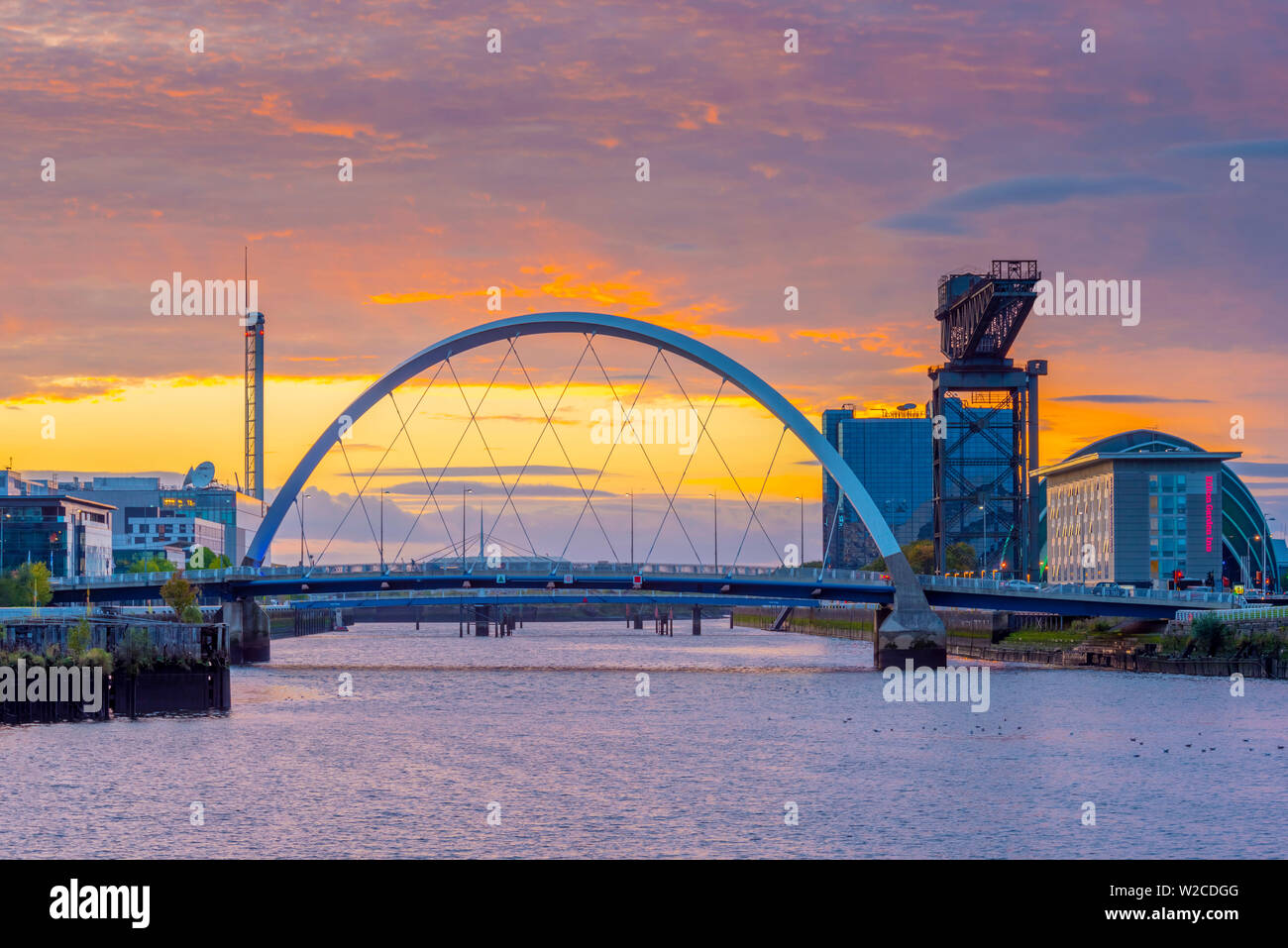 UK, Scotland, Glasgow, River Clyde, Finnieston Crane and the Clyde Arc, nicknamed the Squinty Bridge Stock Photo