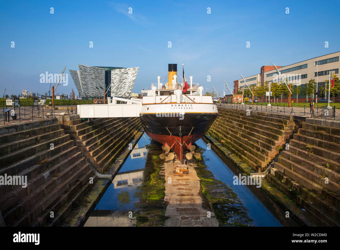 United Kingdom, Northern Ireland, Belfast, The SS Nomadic - Tender to the Titanic and the last remaining White Star Line ship infront of the Titanic Belfast museum - Stock Image