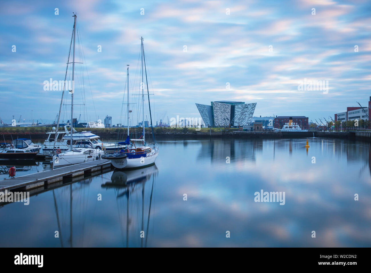 United Kingdom, Northern Ireland, Belfast, View of the Titanic Belfast museum and The SS Nomadic - Stock Image