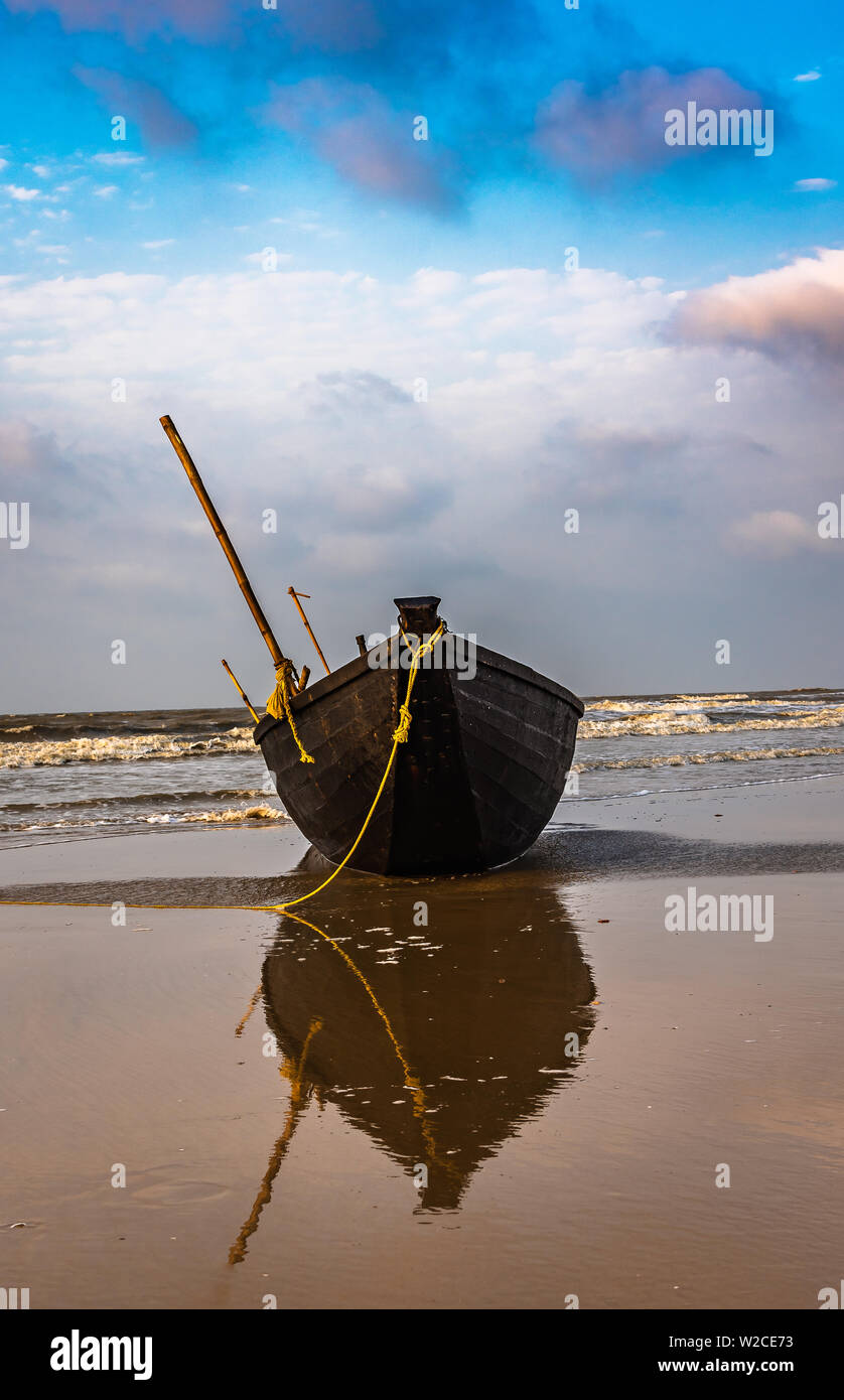 Silhouette Boats anchored on the sea Beach at Digha beach. - Stock Image