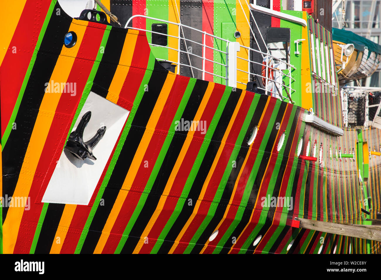 "United Kingdom, England, Merseyside, Liverpool, Albert Dock, The ""Edmund Gardner"" Dazzle Ship by artist Carlos Cruz-Diez, situated in a dry dock - Stock Image"