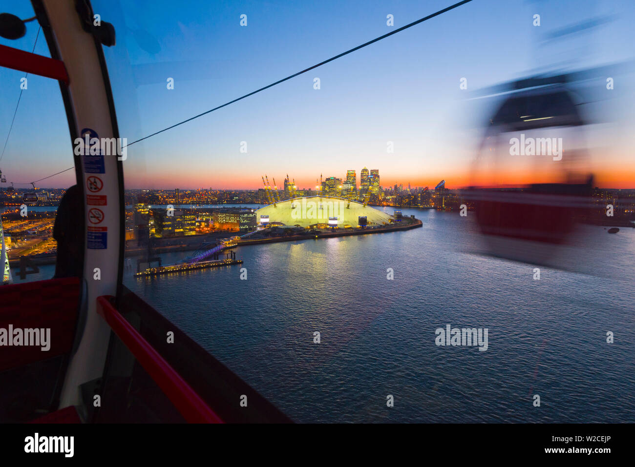 UK, England, London, O2 Arena (formerly Millennium Dome) and Canary Wharf skyline from the Emirates Air Line or Thames Cable Car over River Thames, from Greenwich Peninsula to Royal Docks Stock Photo