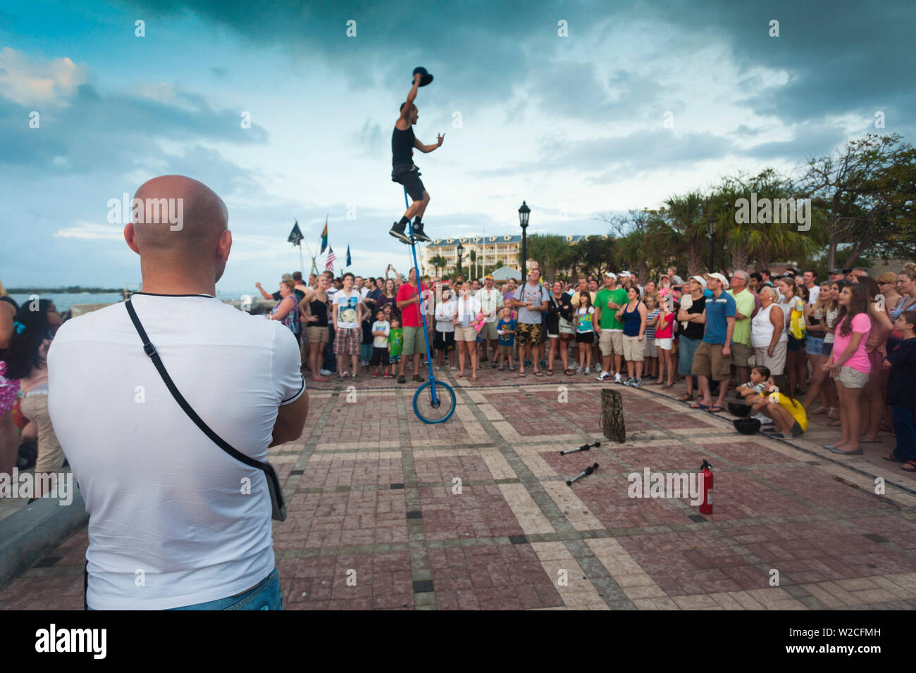 USA, Florida, Florida Keys, Key West, Mallory Square, daily sunset party, watching the juggler Stock Photo