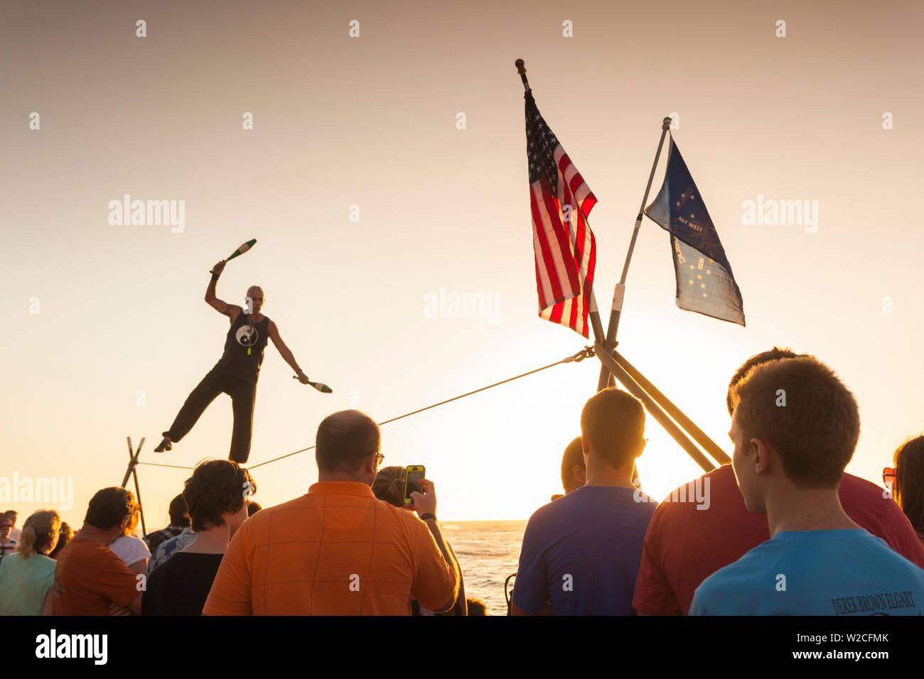 USA, Florida, Florida Keys, Key West, Mallory Square, daily sunset party, watching the juggler Stock Photo