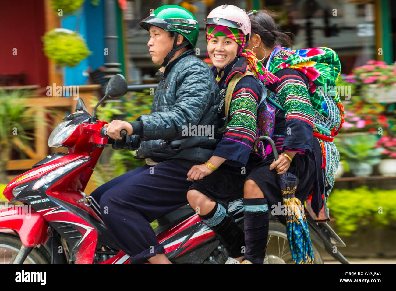 Black Hmong tribes women on scooter, Sapa, N.Vietnam - Stock Image