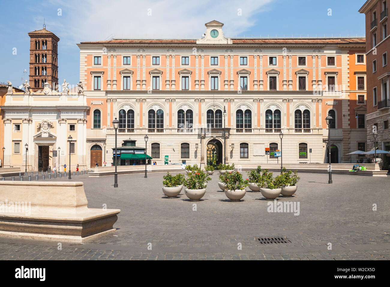 Rome, Italy - August 8, 2015: Rome street view. Piazza di San Silvestro, people walk near Church of Saint Sylvester the First - Stock Image